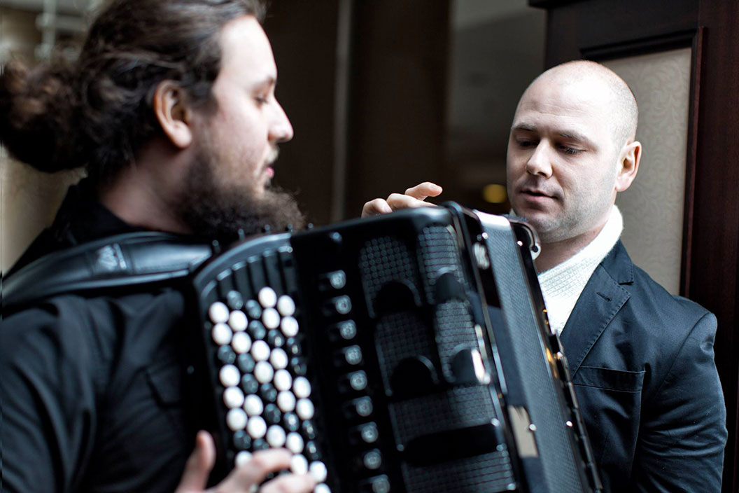 Marcin Wyrostek and Jakub Milszewski playing accordion